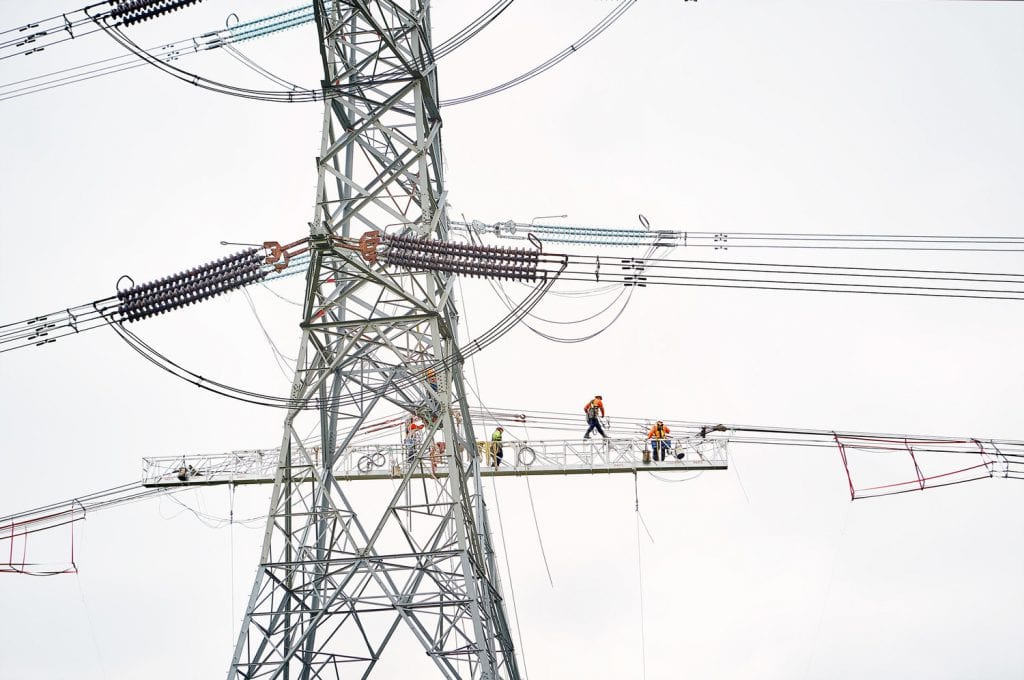 People at work - High up on pylon